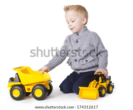 Cute Boy playing with toy trucks - stock photo
