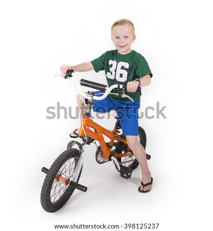 Cute boy riding his bike isolated on white background - stock photo