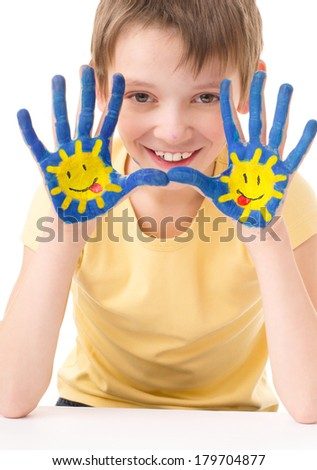 cute boy showing his hands with painted sun, isolated over white - stock photo