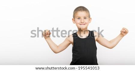 Cute boy showing muscles - stock photo
