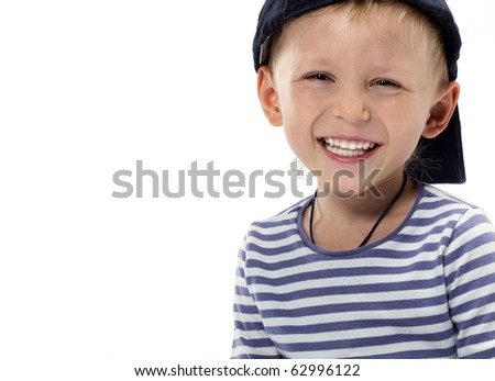 cute boy sitting on white background - stock photo