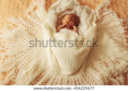 cute boy sleeping in big bed - stock photo