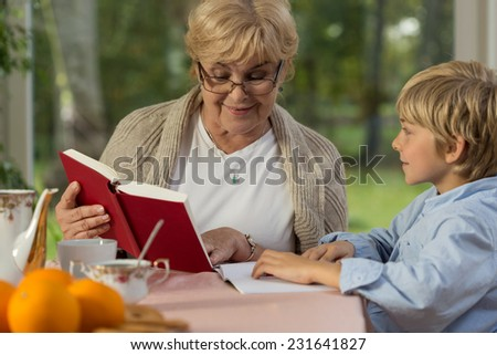 Cute boy spending time at grandma's home - stock photo