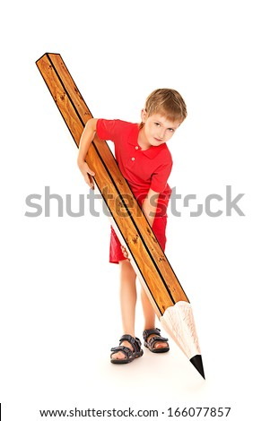 Cute boy standing with a huge pencil. Education. Isolated over white. - stock photo