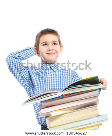 Cute boy studying and reading a book. Isolated on white studio shot - stock photo