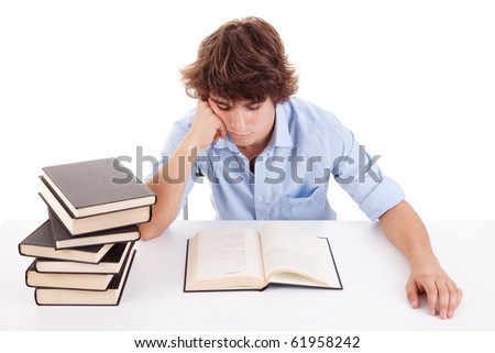 cute boy studying and reading a book on his desk, isolated on white, studio shot - stock photo