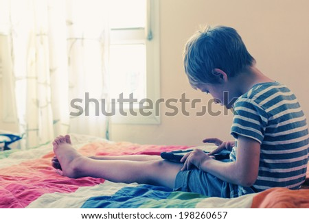 Cute boy using a laptop - stock photo