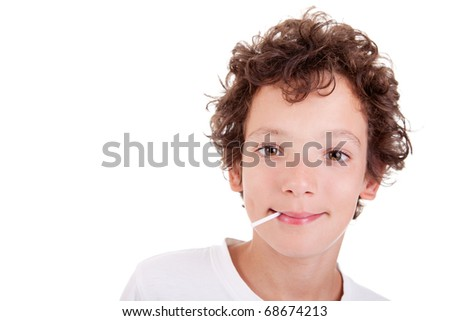 Cute Boy with a candy on mouth smiling, isolated on white, studio shot - stock photo