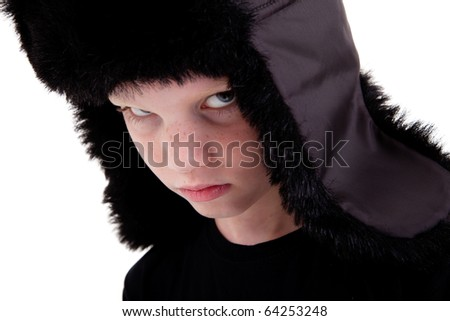 cute boy with a cap, bored,  isolated on white background, studio shot. - stock photo