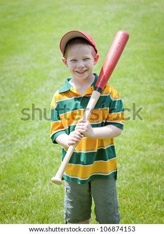Cute boy with big smile outdoors on with baseball bat portrait - stock photo