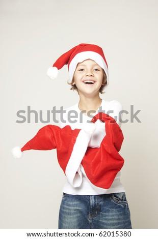 Cute boy with christmas cap - stock photo