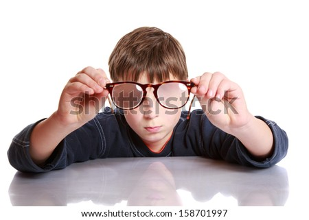 cute boy with glasses and low vision - stock photo