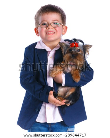 Cute boy with his Yorkshire terrier smiling at camera on isolated white background - stock photo