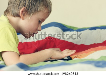 cute boy with laptop - stock photo
