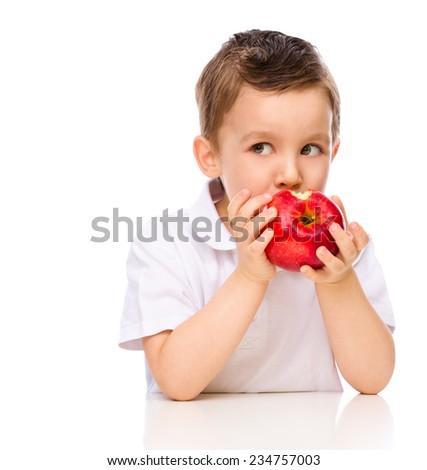 Cute boy with red apples, isolated over white - stock photo