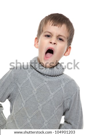Cute boy yawning isolated on a white background - stock photo