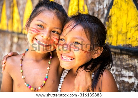 Cute Brazilian indians paying in Amazon, Brazil - stock photo