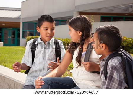 Cute Brothers and Sister Talking, Wearing Backpacks Ready for School. - stock photo