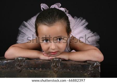Cute brunette ballet girl wearing a pink ballet costume - stock photo