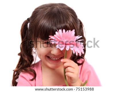 Cute brunette four year old girl being shy, hiding behind a colorful pink daisy on a white background - stock photo