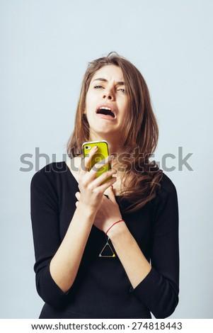 cute brunette girl upset over SMS - stock photo