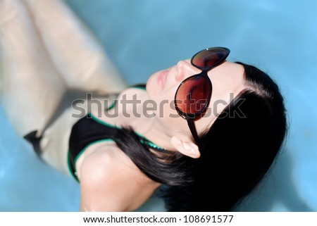 cute brunette girl with big glasses - stock photo