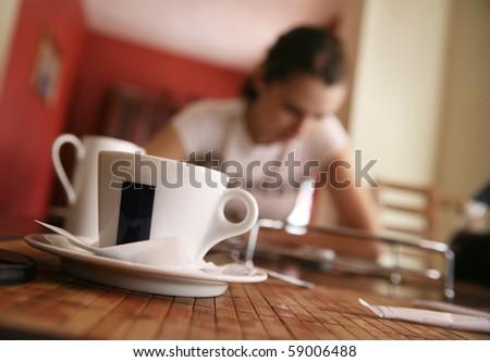 Cute brunette on a coffee-break - stock photo
