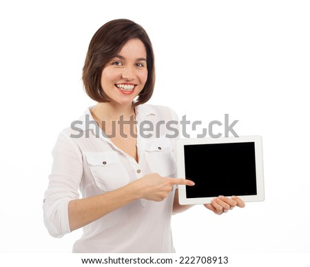 Cute brunette showing a blank touchpad with her finger, communication concept, isolated on white - stock photo