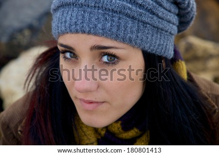 Cute brunette with green eyes and hat and scarf feeling sad - stock photo