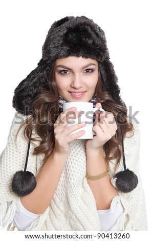 Cute brunette with hat and a cup - stock photo