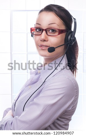 Cute business woman with headset at workplace - stock photo