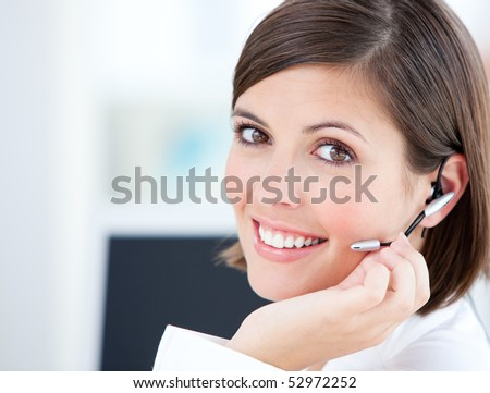 Cute businesswoman talking with clients in front of her computer in the office - stock photo