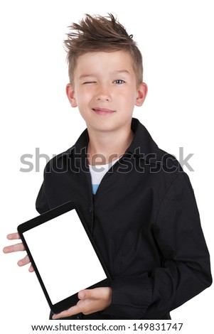 Cute casual boy holding tablet with white screen facing toward camera.  - stock photo
