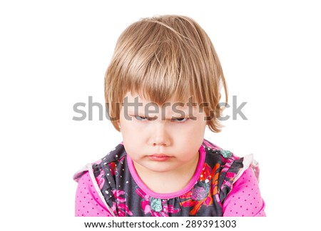Cute Caucasian blond baby girl angry frowns, studio portrait isolated on white background - stock photo