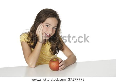 Cute Caucasian girl happy about eating an apple - stock photo