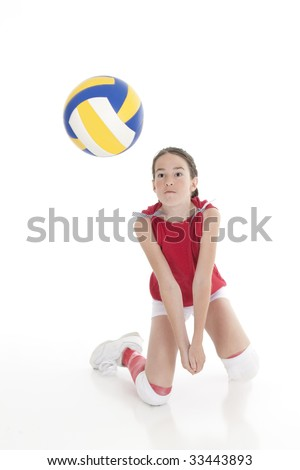 Cute Caucasian girl hitting the ball in volleyball - stock photo
