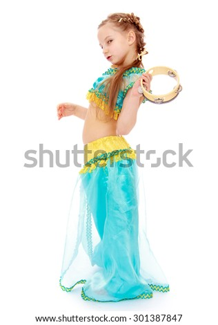 Cute Caucasian girl in east suit. Girl holding a tambourine-Isolated on white background - stock photo