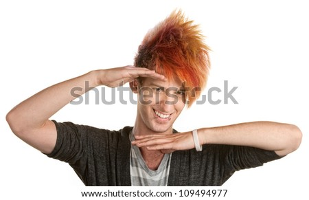 Cute Caucasian male with lip piercing gesturing with hands - stock photo