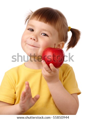 Cute cheerful child is going to bite a red apple, isolated over white - stock photo
