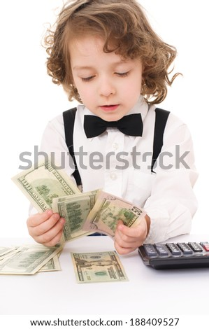 Cute cheerful kid is counting dollars, isolated over white - stock photo