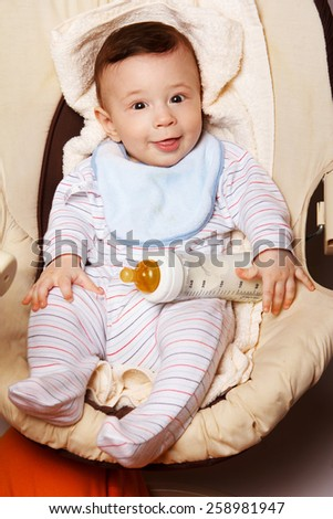 Cute cheerful  little baby boy. - stock photo