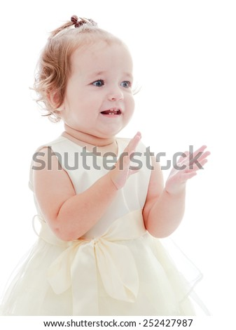 Cute cheerful little girl claps her hands.Isolated on white. - stock photo