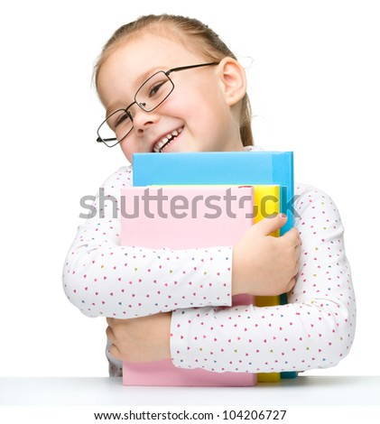 Cute cheerful little girl with books, isolated over white - stock photo