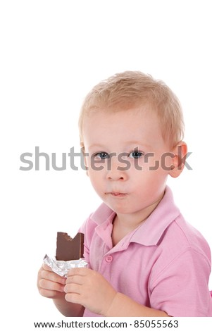 Cute child eating chocolate isolated on white - stock photo