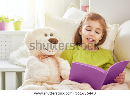 cute child girl reading a book at home. self learning. home study - stock photo