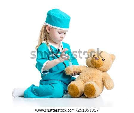 cute child girl with clothes of doctor playing toy - stock photo