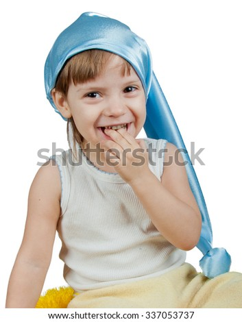 Cute child in blue sleeping hat smiling isolated on white - stock photo