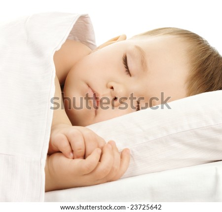 Cute child is sleeping in bed, isolated over white - stock photo