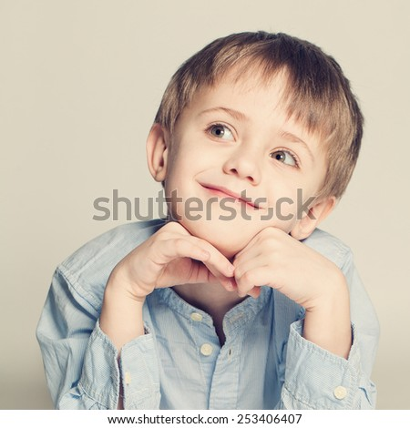 Cute child looking up - stock photo