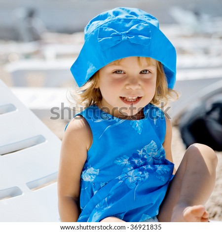 Cute child resting on beach in summer vacation - stock photo
